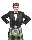 Handsome man in clothing for Scottish dance. Isolated Stock Photography