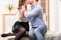Handsome man commiting betrayal with housemaid Stock Photography