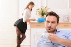 Handsome man commiting betrayal with housemaid Royalty Free Stock Photos
