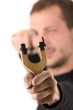 Handsome man concentrated aiming a slingshot Royalty Free Stock Image