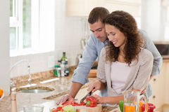 Handsome man cooking with his girlfriend Stock Photo