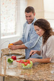 Handsome man cooking with his girlfriend Stock Photos
