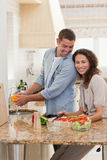 Handsome man cooking with his girlfriend Stock Images