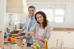 Handsome man cooking with his girlfriend Royalty Free Stock Images