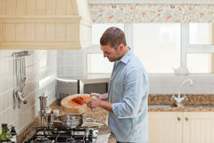 Handsome man cooking in the kitchen Royalty Free Stock Photo