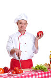 Handsome man cooking in the kitchen at home Stock Photography