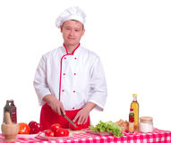 Handsome man cooking in the kitchen at home Royalty Free Stock Photo