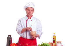 Handsome man cooking in the kitchen at home Stock Images