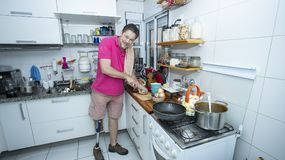 Handsome man cooking and preparing lunch royalty free stock photo