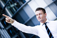 Handsome Man In A Corporate Attire Pointing Up. Photo Of A Handsome Man In A Corporate Attire Pointing Up Royalty Free Stock Photo