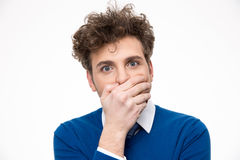 Handsome man covering his mouth. Over white background Stock Image