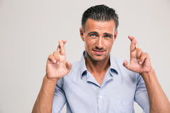 Handsome man cross his fingers Royalty Free Stock Photo