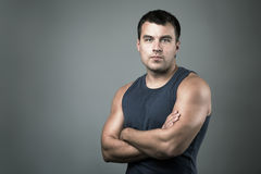 Handsome Man with Crossed Arms. Dramatic Light. Stock Photography