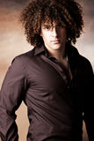 Handsome man with curly hair Stock Photos