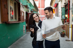 Handsome man and cute woman looking at map Stock Images