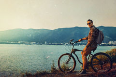 Handsome Man Cyclist Standing With Bicycle On Coast And Enjoying View of Nature Sunset Vacation Traveling Resting Destination Stock Photos