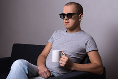 Handsome man in 3d glasses sitting on sofa and watching movie Royalty Free Stock Photos