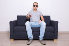 Handsome man in 3d glasses watching tv Royalty Free Stock Photos