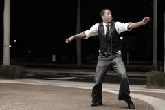 Handsome man dancing Stock Images