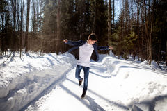 Handsome Man Dancing On Snow Background Stock Photography
