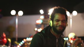Handsome man dancing to the rhythm of music with headphones stock video