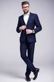 Handsome man in dark blue suit and white shirt. With  glasses Royalty Free Stock Images