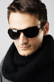 Handsome man in dark sunglasses and black scarf Stock Image