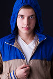 Handsome man dark winter fashion, wearing hood jacket Royalty Free Stock Image