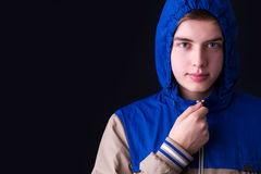Handsome man dark winter fashion, wearing hood jacket Stock Image