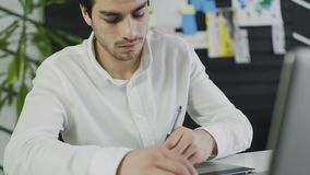 Handsome man, designer working in creative agency office. stock video footage
