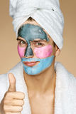 Handsome man with different face masks shows thumbs up! Stock Photos