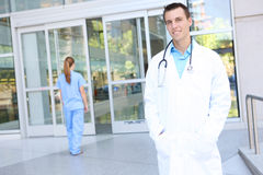 Handsome Man Doctor at Hospital. An attractive man doctor outside hospital building Royalty Free Stock Photo
