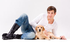 Handsome man with dog over gray Stock Photography