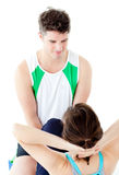 Handsome man doing fitness exercises with a woman Royalty Free Stock Photography
