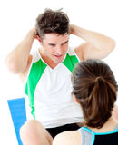 Handsome man doing fitness exercises with a woman Royalty Free Stock Photo