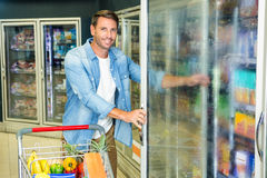 Handsome man doing grocery shopping Stock Photo