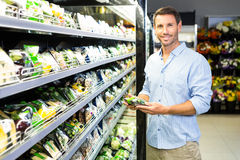 Handsome man doing grocery shopping Royalty Free Stock Image