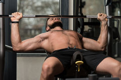 Handsome Man Doing Heavy Weight Exercise For Chest Royalty Free Stock Photos