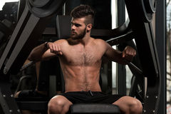 Handsome Man Doing Heavy Weight Exercise For Chest Stock Image