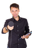 Handsome man doing interview with notes and microphone Stock Photo