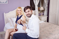 Handsome man doing a marriage proposal while offering his wife an engagement ring. Stock Image