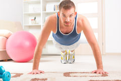Handsome man doing push ups Stock Photos