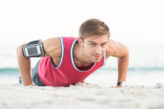 Handsome man doing push ups Royalty Free Stock Images