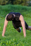Handsome man doing push-ups Royalty Free Stock Photography