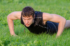 Handsome man doing push-ups Stock Photo