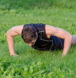 Handsome man doing push-ups Stock Photos
