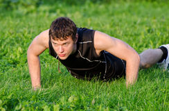 Handsome man doing push-ups Stock Images