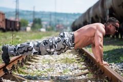 Handsome Man Doing Pushups At Railroad Stock Image