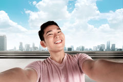 Handsome man doing selfie Royalty Free Stock Images