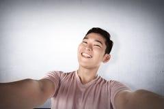 Handsome man doing selfie Stock Photos